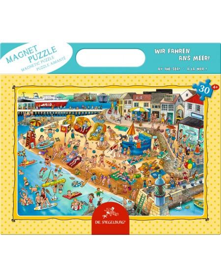 Magneet puzzel aan zee
